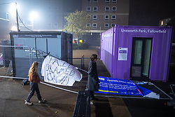 "© Licensed to London News Pictures. 05/11/2020. Manchester, UK. "" PAID BLAMED CAGED "" banner suspended from fencing on the campus . Hundreds of students protest and march through the campus , tearing down fences where The University of Manchester have erected fencing around student accommodation blocks , at the Owens Park campus of the UoM , on the first day of a national coronavirus lockdown in England . Students living at halls of residence on the site say no notification was given ahead of the erection of fences , which the university claims are for students' security. Photo credit: Joel Goodman/LNP"
