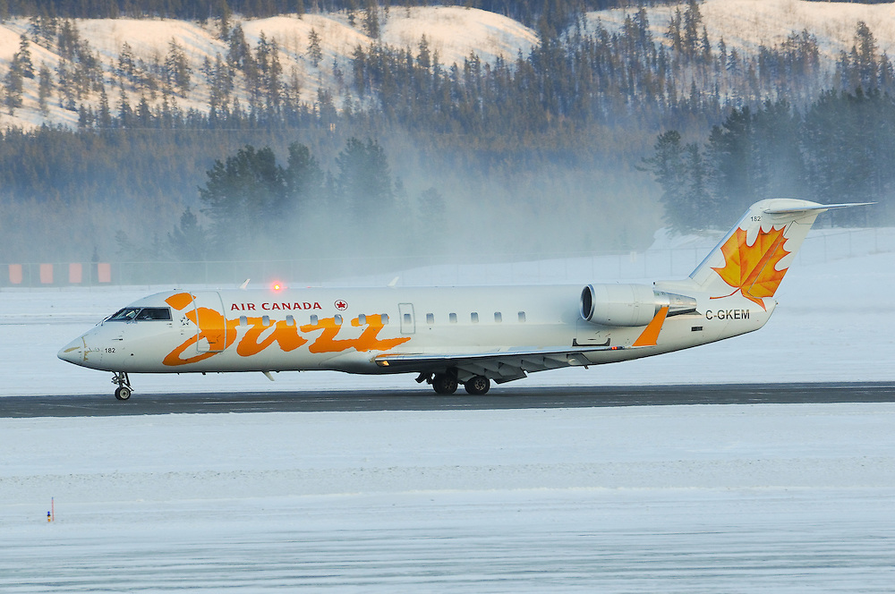 Air Canada Jazz CRJ-200 stopping on a slippery runway