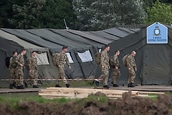 © licensed to London News Pictures. London, UK 19/07/2012. Soldiers walking at the military base in Hainault Country Park in Redbridge, east London. The base will accommodate 3,000 soldiers during the Olympics. Photo credit: Tolga Akmen/LNP