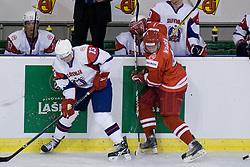 Jan Mursak of Slovenia and Patryk Wajda of Poland at IIHF Ice-hockey World Championships Division I Group B match between National teams of Poland and Slovenia, on April 17, 2010, in Tivoli hall, Ljubljana, Slovenia. (Photo by Matic Klansek Velej / Sportida)