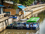 09 SEPTEMBER 2016 - BANGKOK, THAILAND:  Passenger boats at the southern terminus of the new commuter boat line near Hua Lamphong train station. Trial services have started on a 5-kilometre boat route on Khlong Phadung Krung Kasem between Hua Lamphong and Thewes piers. The service is operated by the Bangkok Metropolitan Administration (BMA). The city is using converted garbage boats, fitted with seats, awnings and life preservers. If the trial run is successful regular passenger boats will be put on the route.      PHOTO BY JACK KURTZ