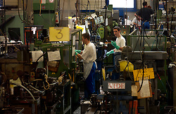 HERSTAL, BELGIUM - JUNE-13-2003 - Technicians work on manufacturing the many small parts of firearms at the FN Herstal weapons fabrication plant near Liege, Belgium. (PHOTO © JOCK FISTICK)