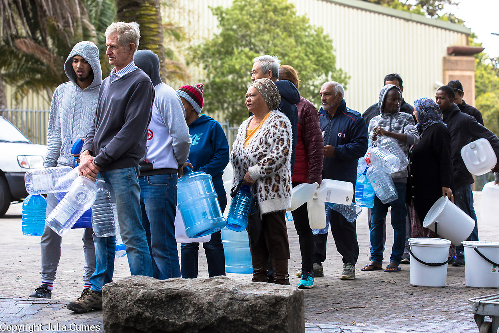 Capetonians line up with their water containers at the Newlands spring in a suburb of Cape Town. The spring, whose water is supplied by nearby Table Mountain, has flowed without interruption since record keeping started in South Africa, but has only recently becoming a critical collection point. Because of rising water costs and tight restrictions on municipal water usage, local residents come to the spring to fill up on the clean mountain water they use primarily for drinking and cooking.