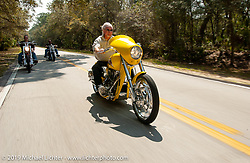 Arlen Ness riding his latest custom through Tomoka State Park during Daytona Bike Week. Daytona Beach, FL. Photography ©2003 Michael Lichter.