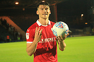 HAT-TRICK Kieffer Moore with the match ball during the EFL Sky Bet League 1 match between Rochdale and Barnsley at Spotland, Rochdale, England on 21 August 2018.