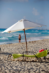 10 Feb 2014. Cancun, Mexico.<br /> A parasol on the tourist beach at Isla Cancun along the Zona Hotelera on the Carribean Sea. <br /> Photo; Charlie Varley/varleypix.com