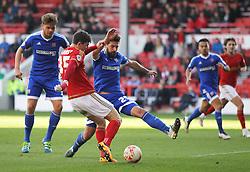 Oliver Burke of Nottingham Forest (C) has a shot at goal - Mandatory by-line: Jack Phillips/JMP - 02/04/2016 - FOOTBALL - City Ground - Nottingham, England - Nottingham Forest v Brentford - Sky Bet Championship