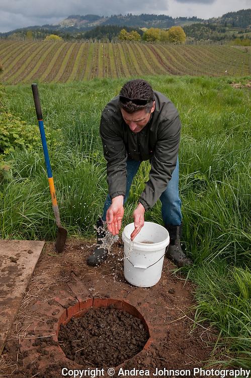 Paul de Lancellotti practicing biodynamic procedures on his estate vineyard, Willamette Valley, Oregon