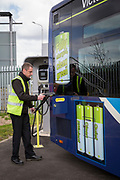 A Nottingham Community Transport bus driver plugging in one of the Ecolink zero emissions buses to charge in Nottingham, Nottinghamshire, United Kingdom. <br /> (photo by Andrew Aitchison / In pictures via Getty Images)