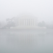 The Jefferson Memorial in a dense fog over the Tidal Basin on a cold winter's day in Washington DC.
