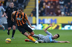 Hull City's Jake Livermore is tackled by Newcastle United's Ayoze Perez - Photo mandatory by-line: Richard Martin-Roberts/JMP - Mobile: 07966 386802 - 31/01/2015 - SPORT - Football - Hull - KC Stadium - Hull City v Newcastle United - Barclays Premier League