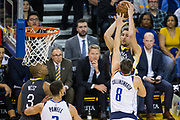 Golden State Warriors guard Klay Thompson (11) shoots a jumper over Dallas Mavericks guard Kyle Collinsworth (8) at Oracle Arena in Oakland, California, on February 8, 2018. (Stan Olszewski/Special to S.F. Examiner)