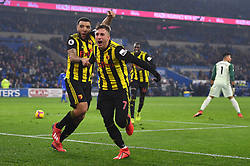 Watford's Troy Deeney (left) celebrates scoring his side's fourth goal of the game with team-mate Gerard Deulofeu during the Premier League match at the Cardiff City Stadium.