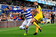 Queens Park Rangers striker Conor Washington (9) battles for the ball with Burton Albion defender Ben Turner (6)  during the EFL Sky Bet Championship match between Queens Park Rangers and Burton Albion at the Loftus Road Stadium, London, England on 23 September 2017. Photo by Richard Holmes.