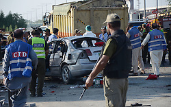 July 25, 2017 - Lahore, Punjab, Pakistan - Pakistani security officials collect evidence from the scene of a blast. At least 29 people were killed and 55 injured on a suicide attack in Pakistan's northeastern city of Lahore, emergency officials said.but it was not immediately clear what caused the blast.(The explosion) seems like a suicide blast targeting police, but we are still ascertaining the nature of the explosion,' the city's commissioner Abdullah Khan Sumbul said. (Credit Image: © Rana Sajid Hussain/Pacific Press via ZUMA Wire)