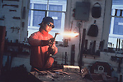A woman welder operating a blowtorch