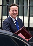 © Licensed to London News Pictures. 20/03/2013. Westminster, UK. David Cameron, Conservative MP, Prime Minister, ... Chancellor Of The Exchequer George Osborne poses for photographers whilst holding his red ministerial box outside 11 Downing Street In London, before presenting his annual budget to parliament today 19th March 2013. Photo credit : Stephen Simpson/LNP