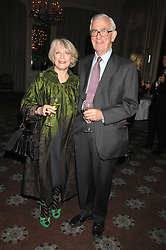 LUCIA VAN DER POST and her husband NEIL CRICHTON-MILLER at a dinner to celebrate the launch of the Dom Ruinart 1998 vinatage champage at Claridge's, Brook Street, London W1 on 23rd April 2008.<br /><br />NON EXCLUSIVE - WORLD RIGHTS