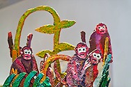 Roslyn, New York, U.S. - April 12, 2014 - During International Slow Art Day, artist Hunt Slonem's colorful sculptures of monkeys, wildlife and tropical plants, are part of the Garden Party exhibit at the Nassau County Museum of Art on Long Island. During this annual worldwide event, those participating (not known if person shown is participant) went to local museums and viewed a small number of works of art, each for at least 10 minutes, and then discussed them afterward.