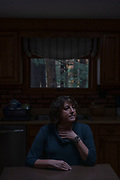 """NH 10/28/19 11:31:28 AM <br /> Janine Dunphy at a cabin her family owns in New Hampshire on Monday, October 28, 2019. """"This is the only place in the world where I feel safe,"""" she said. Dunphy, who lives in Danvers, Massachusetts, reported she was raped by a man, Mark Papamechail, who she had met through the dating app PlentyofFish. He still lives in her neighborhood. Papamechail was later accused of rape by another woman he met through Tinder, Susan Deveau, who returned to drinking after reporting her rape allegation against Papamechail. She died as a result of her relapse. <br /> <br /> Sarah Rice for ProPublica"""
