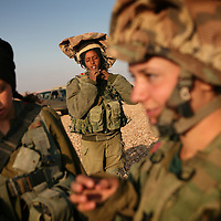 Israeli women soldiers of the mixed-gender 'Caracal' infantry battalion prepare for a training session, December 2009.