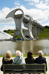 Visitors looking at The Falkirk Wheel a modern ship lift on the Forth and Clyde Canal in Scotland