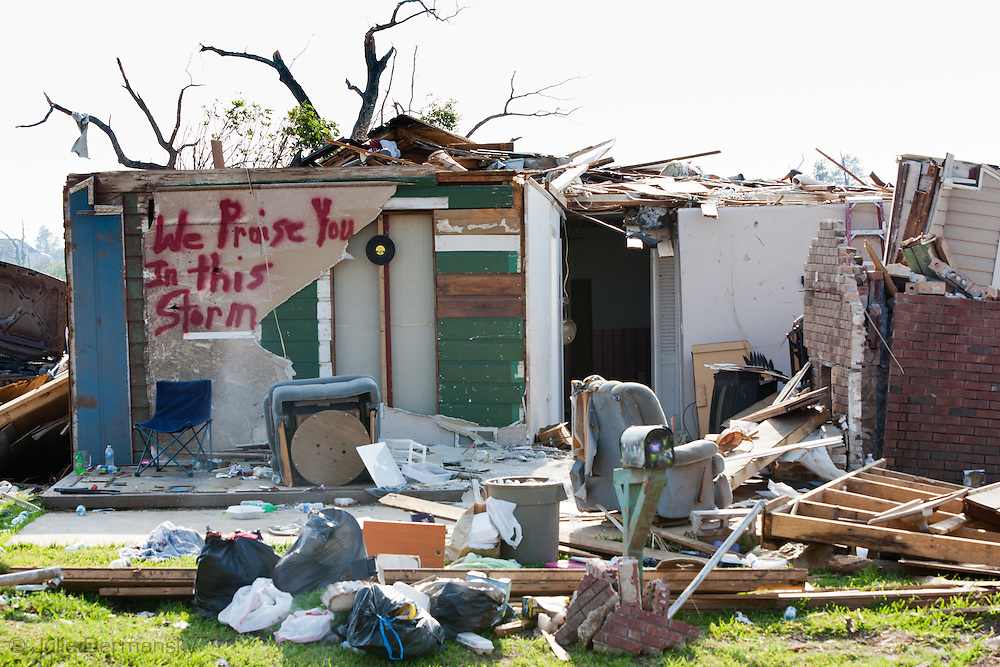 Destoryed home in Tuscaloosa Alabama after being hit by a tornado with a message praising the storm painted on it . Tuscaloosa was hit by  F-4 and  possibly  F-5 tornados that were part of a storm  of an estimated 300 that struck Alabama and the neighboring states on April 27th , 2011.