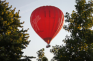 © Rob Arnold.  31/07/2014. Hampshire, UK. A group of people have an early start to take a balloon flight from Basingstoke in Hampshire. The balloon flights depart from War Memorial Park in the centre of Basingstoke, and fly for around 2 hours to wherever the wind takes them. Photo credit : Rob Arnold