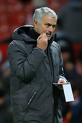 13th December 2017 - Premier League - Manchester United v Bournemouth - Man Utd manager Jose Mourinho holds a pen in his mouth as he carries a notepad off after the match - Photo: Simon Stacpoole / Offside.