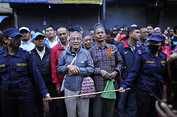 April 28, 2018 - Kathmandu, NP, Nepal - Nepalese male devotees blocked by female nepalese police personnel during Nepalese Female devotees arranging to pull the chariot of the Rato Machindranath from Lagankhel to Thati tole on Saturday, April 28, 2018. As per time honored tradition, the chariot is pulled exclusively by women. This part of the chariot procession is known as Yakah Misaya Bhujya. Rato Machindranath is also said as the 'god of rain' and both Hindus and Buddhists worship the Machindranath in hope of good rain to prevent drought during the rice plantation season. (Credit Image: © Narayan Maharjan/NurPhoto via ZUMA Press)