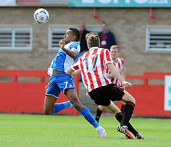 Christian Montano of Bristol Rovers is challenged by Daniel Parslow of Cheltenham Town - Mandatory by-line: Neil Brookman/JMP - 25/07/2015 - SPORT - FOOTBALL - Cheltenham Town,England - Whaddon Road - Cheltenham Town v Bristol Rovers - Pre-Season Friendly