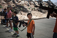 Sarosi family learns how to walk holding with a rifle practicing with a fake M16. The participants learn how to react to a terrorist attack.