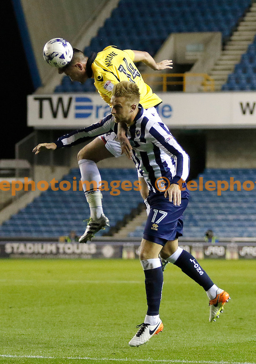 Bolton's Gary Madine beats Millwall's Byron Webster to the ball during the Sky Bet League 1 match between Millwall and Bolton Wanderers at The Den in London. October 18, 2016.<br /> Carlton Myrie / Telephoto Images<br /> +44 7967 642437