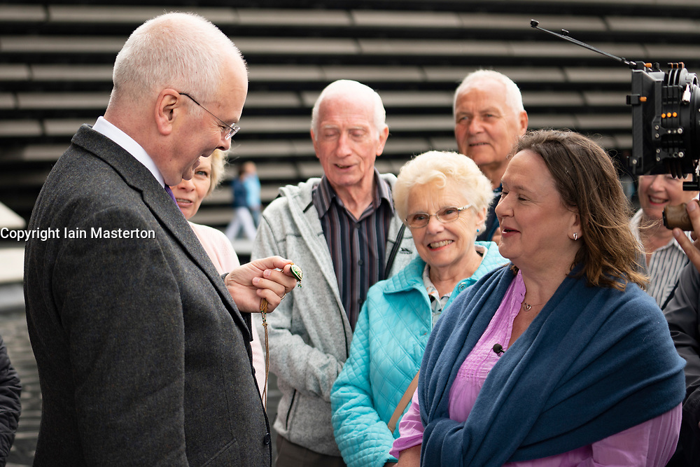 Dundee, Scotland, UK. 23 June 2019. The BBC Antiques Roadshow TV programme is aiming on location t the new V&A Museum in Dundee today. Long queues formed as members of the public arrived with their collectables to have them appraised and valued by the Antiques Roadshow experts. Select items and their owners were chosen to be filmed for the show. Pictured, Expert Geoffrey Munn discussing valuable jewellery with an owner.