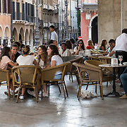 TREVISO, ITALY - AUGUST 24:  Customers sits at a cafe in the city centre on August 24, 2013 in Treviso, Italy. Treviso claims that Tiramisu was invented in the 1960s by Alba Campeol, the owner of the Restaurant called ÒAlle BeccherieÓ, who supposedly wanted to create a dessert that would give her an energy boost after the birth of her son.  (Photo by Marco Secchi/Getty Images)
