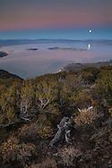 Full moon rising over Mono Lake in the evening, Mono County, Eastern Sierra, California