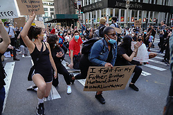 Protestors kneel down as they rally against the death of Minneapolis, Minnesota man George Floyd at the hands of police on May 31, 2020 in New York City. Floyd's death was captured in video that went viral of the incident. Minnesota Gov. Tim Walz called in the National Guard today as looting broke out in St. Paul.