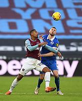 Football - 2020 / 2021 Premier League - West Ham United vs Brighton & Hove Albion - London Stadium<br /> <br /> West Ham United's Sebastien Haller battles with Brighton & Hove Albion's Adam Webster.<br /> <br /> COLORSPORT/ASHLEY WESTERN