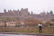 Carcassonne. Languedoc. The modern bridge across the Aude river. View over the old city. A rainy and misty winter day. France. Europe.