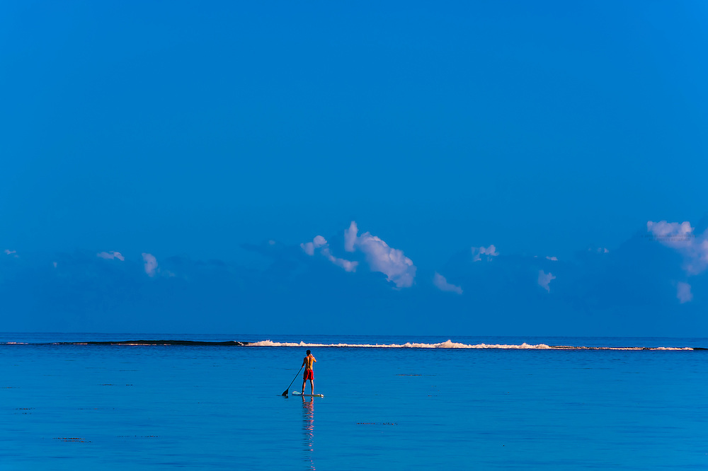 Stand up paddleboarding, island of Moorea, French Polynesia.