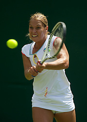 23.06.2011, Wimbledon, London, GBR, Wimbledon Tennis Championships, im Bild Dominika Cibulkova (SVK) in action during the Ladies' Singles 2nd Round match on day four of the Wimbledon Lawn Tennis Championships at the All England Lawn Tennis and Croquet Club, EXPA Pictures © 2011, PhotoCredit: EXPA/ Propaganda/ *** ATTENTION *** UK OUT!