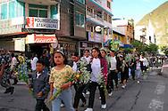 People waking to The Basillica of Nuestra Senora del Aqua Santa in Banos, Ecuador.