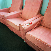 A half-eaten bar of chocolate has been left on an armchair supplied by the Ministry of Defence (MoD) is seen in a crew room at RAF Akrotiri in Cyprus. Much of the facilities at RAF and MoD outposts are basic and spartan leaving small luxuries to be imported by visiting air and ground crew. In this case, the 'Red Arrows', Britain's prestigious Royal Air Force aerobatic team, are occupying this building while on their detachment to the British Mediterranean base while putting the finishing touches to their air display routines ready for PDA (or 'Public Display Authority'). After passing this test, they are then allowed by senior RAF officers to perform as a military aerobatic show in front of the public - following a special test flight when their every move and mistake is assessed and graded. Until that day arrives, their training and practicing is done in the privacy of their own airfield at RAF Scampton in Lincolnshire, UK or here in the glare of Akrotiri. The pilots are called Reds and their ground crew, the Blues after their summer air show uniforms. Since 1965 the team has flown over 4,000 air shows in 52 countries.