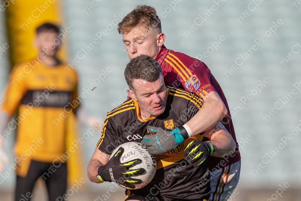Dr. Croke's Shane Doolan is tackled by St Joseph's Miltown's Jamsie O'Connor