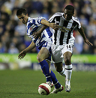 Photo: Lee Earle.<br /> Reading v Newcastle United. The Barclays Premiership. 30/04/2007.Reading's Shane Long (L) battles with Charles N'Zogbia.