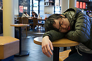 young adult boy sleeping in a public space Japan