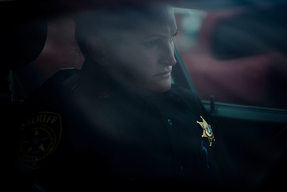Having just pulled over a vehicle after seeing a young child unrestrained and moving about freely, Sergeant Cheryl Crumley contemplates one of the violations she despises the most. She let the man off with a stern warning.