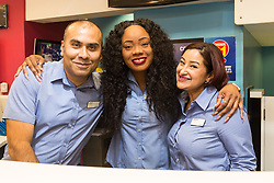Betting Shop Manager-of-the-Year Amran Al-Haque poses with staff members Elaine Norbert and Vanessa Lopez at Coral, 1 Canada Square, Canary Wharf, London, November 08 2018.