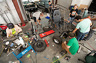 The University of West Florida SAE Baja Team works on their car to compete at SAE Baja Kansas. The University of West Florida will be traveling to Pittsburg, Kansas Wednesday May 16 2018 to compete against over 99 other universities in the 4 day event. This will be the first-ever competition for the UWF SAE Team Baja: A team of Mechanical Engineering students founded in January 2017. (Michael Spooneybarger/ Division of Research and Strategic Innovation)