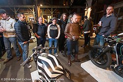Checking out BMW's on display Friday night at the One Show motorcycle show in Portland, OR. February 12, 2016. ©2016 Michael Lichter